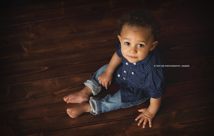 White Bear Lake baby boy, blue shirt, stitting, one year