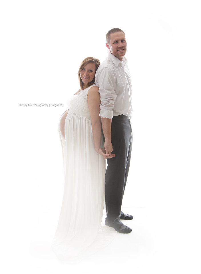 pregnant mom with dad back to back maternity image