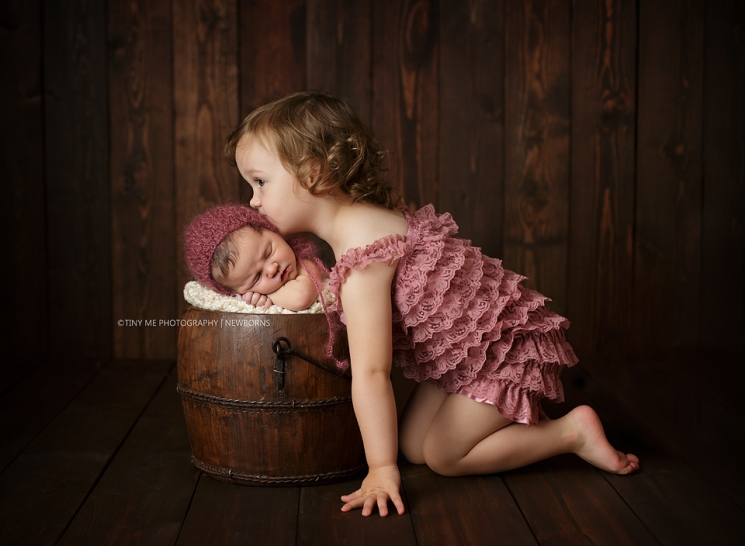 Eagan MN Newborn Photographer Newborn in bucket with big sister Sibling images