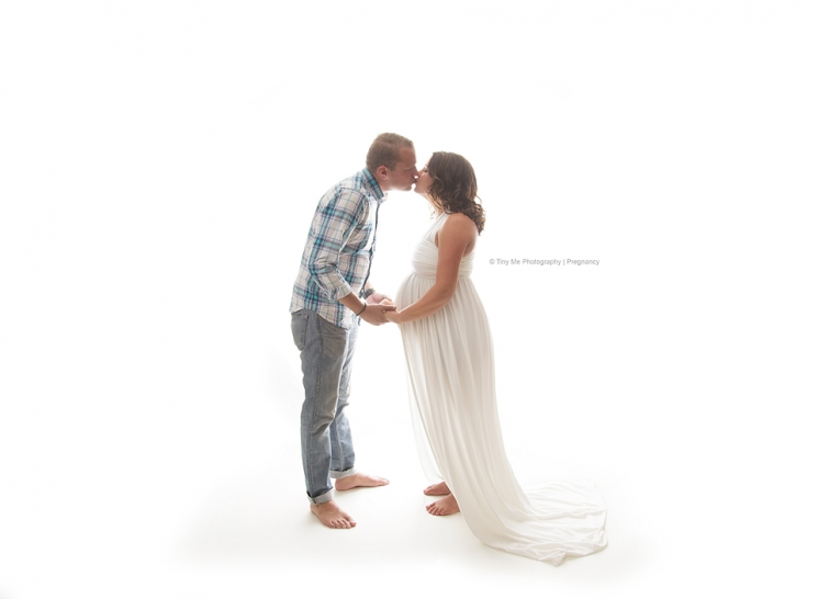 Pregnant mom and dad kiss professional photograph Circle Pines MN