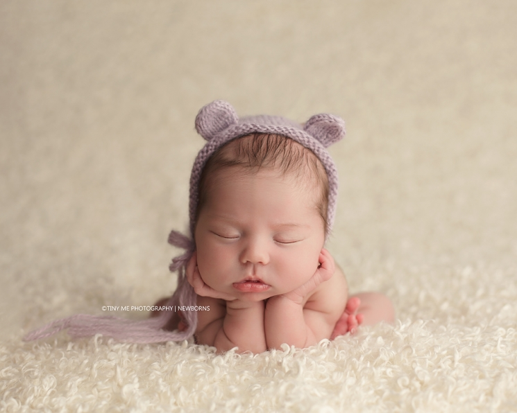 Newborn photographer in Maple Grove wearing purple bear hat prop