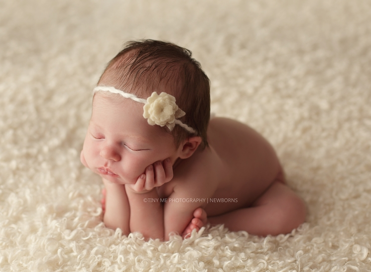 newborn girl with cream headband from Minnesota professional photography