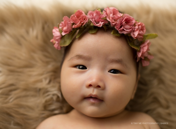 MN Baby photography of older baby wearing flower headband pink