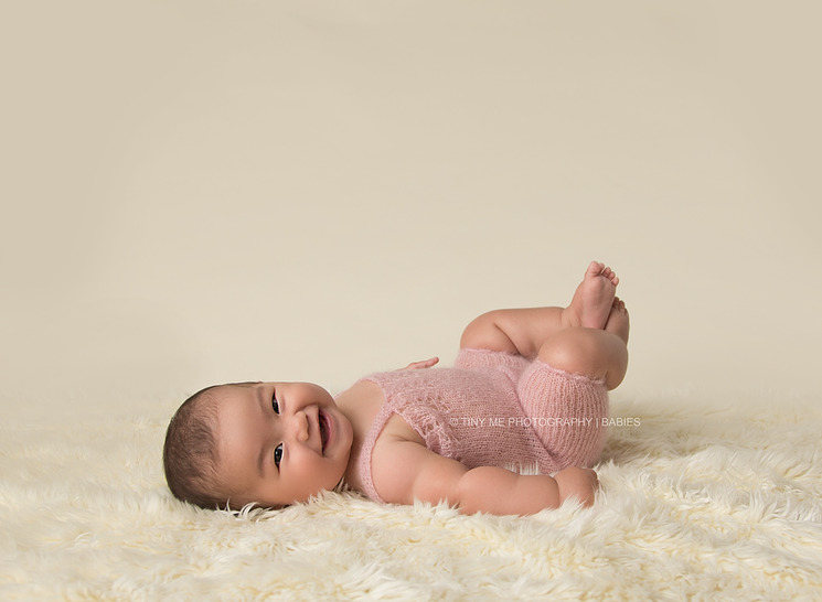 6 month baby girl from MN wearing pink overall prop