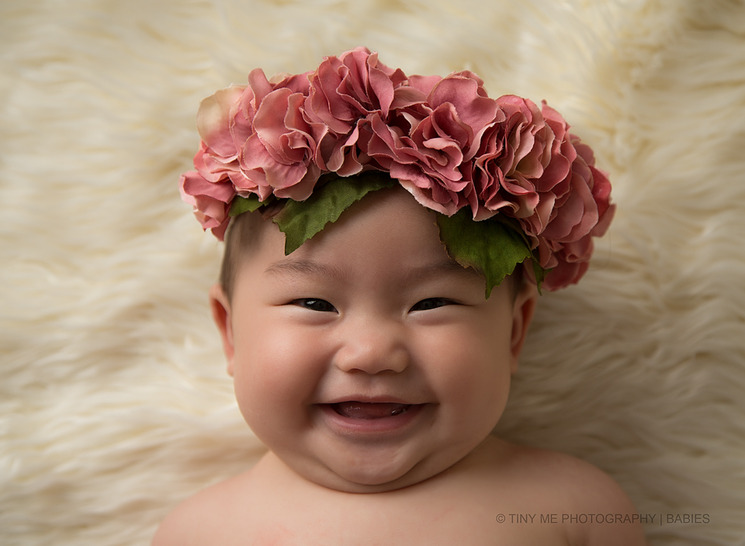 St Paul MN baby photographer 6 month baby girl with flowers