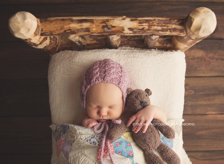 MN best newborn photographer baby girl in bed