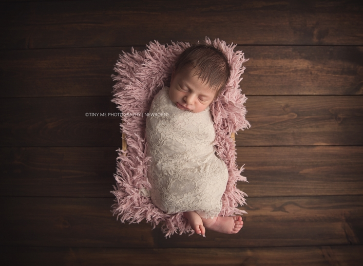 Sleepy newborn girl MN