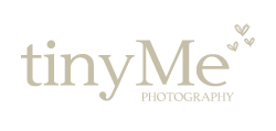 Logo that says Tiny Me Photography with three hearts above it