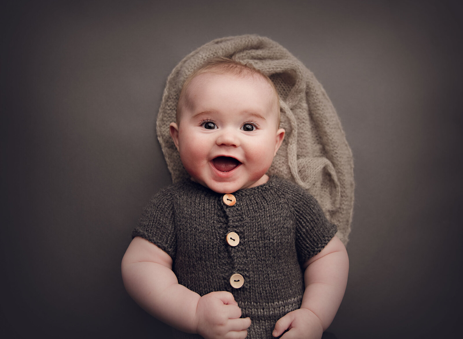 6 month old baby boy smiling